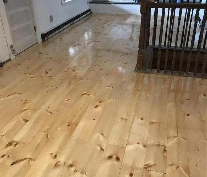Pine floors affected by heavy soot and water After